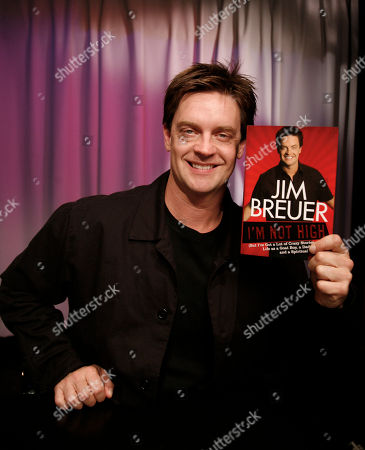 """Jim Breuer Author and comedian Jim Breuer poses with his book """"I'M NOT HIGH"""" (But I've Got a Lot of Crazy Stories about Life as a Goat Boy, a Dad, and a Spiritual Warrior) in New York"""