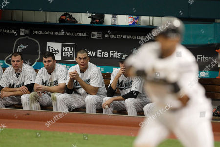 Emilio Bonifacio, Dan Uggla, Mike Stanton Florida Marlins' Emilio Bonifacio, right, bats in the ninth inning as Dan Uggla, second from left, and Mike Stanton, third from left, watch from the dugout during a baseball game against the Philadelphia Phillies in Miami, . The Phillies won 2-1