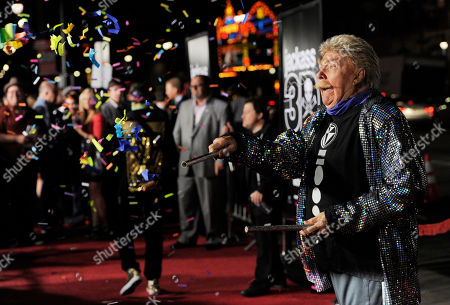 "Rip Taylor Comedian Rip Taylor throws confetti on photographers at the premiere of the film ""Jackass 3D"" in Los Angeles"