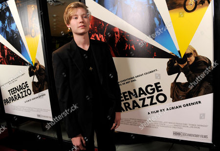 "Stock Photo of Austin Visschedyk Austin Visschedyk, subject of the documentary film ""Teenage Paparazzo,"" poses for photographers at the premiere of the film in Los Angeles"