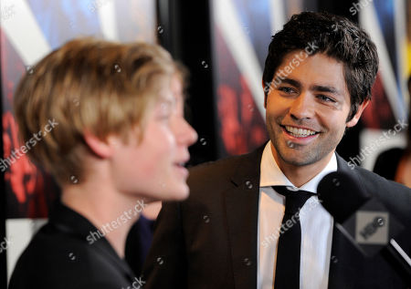 "Stock Image of Adrian Grenier, Austin Visschedyk Adrian Grenier, right, director of the documentary film ""Teenage Paparazzo,"" looks on as the film's subject Austin Visschedyk is interviewed at the premiere of the film in Los Angeles"