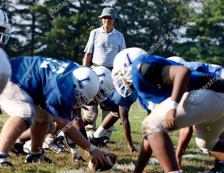 Warren Wolf Lakewood High School football coach Warren Wolf watches his team during practice, in Lakewood, N.J