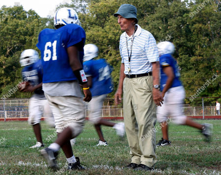 Warren Wolf Lakewood High School football coach Warren Wolf, 83, stands on a field as players run around him during practice, in Lakewood, N.J. Wolf spent 51 years at nearby Brick High School, compiling the most wins ever for a NJ high school football coach. After he retired two seasons ago, he couldn't sit still. Now he's taken a job as coach at Lakewood High School, which has lost 70 of its last 75 games, and had not won in three years