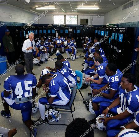 Warren Wolf Lakewood High School football coach Warren Wolf talks to his players before a game against Monsignor Donovan High School, in Lakewood, N.J