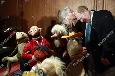 Jane Henson, Willard Scott Jane Henson, left, kisses Willard Scott goodbye on the top of his head, after donating some of Jim Henson's early puppets, in foreground, to the Smithsonian Institution, during a ceremony at the National Museum of American History, in Washington, on