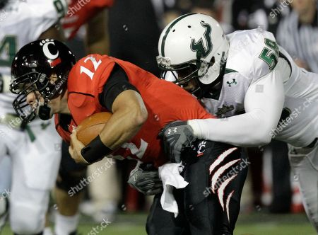 Zach Collaros, David Bedford Cincinnati quarterback Zach Collaros (12) is sacked by South Florida defender David Bedford (58) in the first half of an NCAA college football game, in Cincinnati