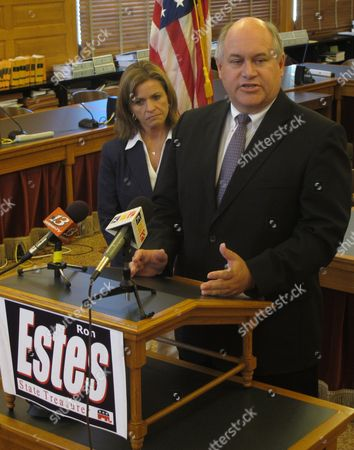 Republican nominee Ron Estes discusses his campaign for Kansas state treasurer as fellow Republican and U.S. Rep. Lynn Jenkins watches during a news conference, at the Statehouse in Topeka, Kan. Jenkins, who's endorsing Estes, was state treasurer in 2003-08