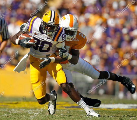 Terrence Toliver, Eric Gordon LSU wide receiver Terrence Toliver (80) is tackled by Tennessee defensive back Eric Gordon (24) during the first half of an NCAA football game in Baton Rouge