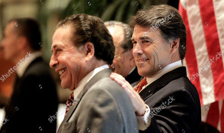 Rick Perry, Farouk Shami Texas Gov. Rick Perry, right, puts his hand on the back of Farouk Shami, left, as he waits to be introduced during the Arab-American Voters forum, in Houston