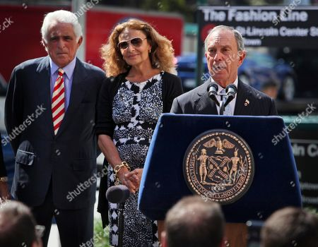 """Stock Picture of Diane von Furstenberg New York City Mayor Michael Bloomberg, right, IMG CEO Ted Forstmann, left, and designer Diane von Furstenberg help to unveil a sign to temporarily rename the No. 1 subway line as """"The Fashion Line"""" for the duration of Fashion Week at a news conference at Lincoln Center in New York, . The runway shows are being held for the first time around Lincoln Center's landmark fountain, on Manhattan's West Side. It had previously been held in Bryant Park in midtown behind the New York Public Library"""