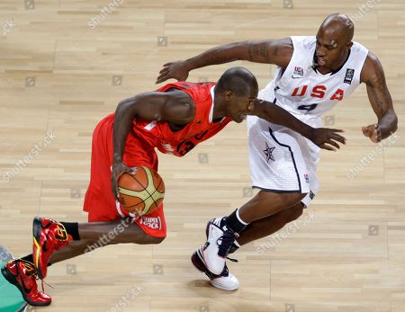 Angola's Carlos Almeida, left, drives past USA's Chauncey Billups during their World Basketball Championship round of 16 match in Istanbul, Turkey