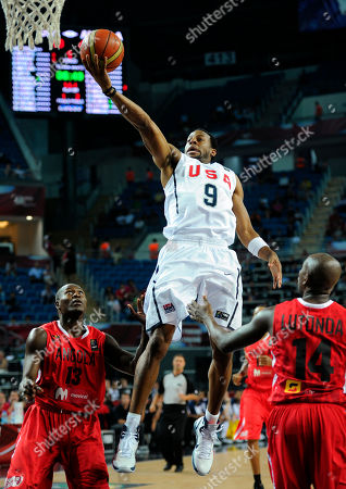 Andre Iguodala, Carlos Almeida, Miguel Lutonda USA's Andre Iguodala, center, goes up for a shot as Angola's Carlos Almeida, left, and Miguel Lutonda defend during the round of 16 of the World Basketball Championship, in Istanbul, Turkey