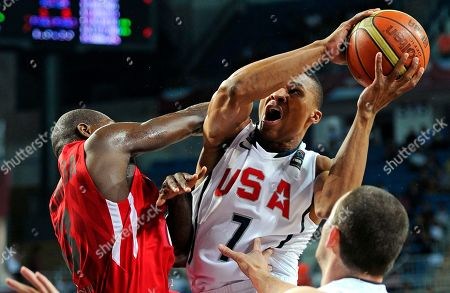 Russel Westbrook, Carlos Almeida USA's Russel Westbrook, right, puts up a shot as Angola's Carlos Almeida defends during the round of 16 at the World Basketball Championship, in Istanbul, Turkey