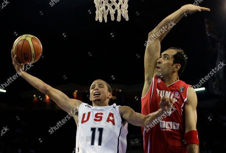USA's Stephen Curry drives to the basket as Tunisia's Radhouane Slimane guards during their World Basketball Championship preliminary round match in Istanbul, Turkey