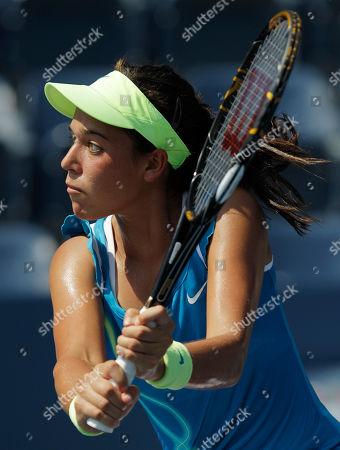Beatrice Capra Beatrice Capra of the United States returns the ball to Aravane Rezai of France at the U.S. Open tennis tournament in New York, . Capra beat Rezai 7-5, 2-6, 6-3