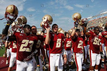Jim Noel, Josh Bordner, Chris Fox, Will Thompson Boston College's Jim Noel (23), Josh Bordner (8), Chris Fox (25) and Will Thompson (50) raise their helmets after losing 19-0 to Virginia Tech in an NCAA college football game, in Boston