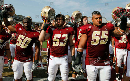 Jim Noel, Josh Bordner, Chris Fox, Will Thompson Boston College's Will Thompson (50), Mike Morrissey (53) and Damik Scafe (55) raise their helmets after losing 19-0 to Virginia Tech in an NCAA college football game, in Boston
