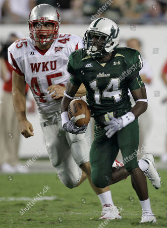 Terrence Mitchell, Cole Tischer South Florida's Terrence Mitchell (14) outruns Western Kentucky's Cole Tischer on a third-quarter return during an NCAA college football game, in Tampa, Fla