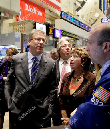 Tom Albanese, James Denaro, Rosemarie Helm Rio Tinto CEO Tom Albanese, left, talks with specialist James Denaro, right, as he visits the post that trades his company's stock on the floor of the New York Stock Exchange . Albanese's mother, Rosemarie Helm, accompanies him on the visit