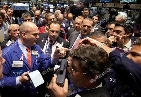Evan Solomon Specialist Evan Solomon, left, takes orders in shares of Citigroup on the floor of the New York Stock Exchange