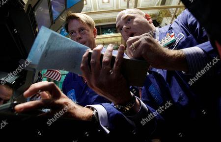 Patrick Murphy, Evan Solomon Specialists Patrick Murphy, left, and Evan Solomon work at a post on the floor of the New York Stock Exchange
