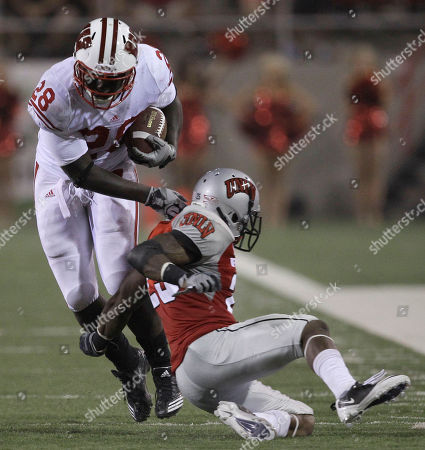 Montee Ball, Brian Bennett Wisconsin's Montee Ball (28) gets past UNLV's Brian Bennett on his way to a first down in the third quarter during an NCAA college football game in Las Vegas
