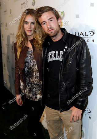 """Stock Image of Christopher """"Drama"""" Pfaff Christopher """"Drama"""" Pfaff, right, and an unidentified guest arrive at the Halo: Reach launch party celebrated by Xbox 360 held at Rob Dyrdek's Fantasy Factory in Los Angeles on"""