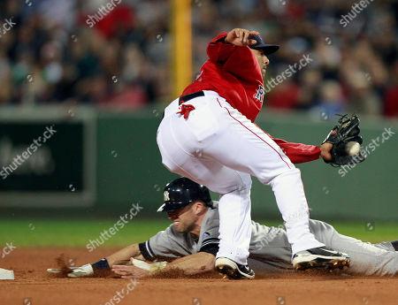 Felipe Lopez, Brett Gardner New York Yankees' Brett Gardner, bottom, steals second base as Boston Red Sox's Felipe Lopez gets the throw in the eighth inning of the first game of a baseball doubleheader, in Boston