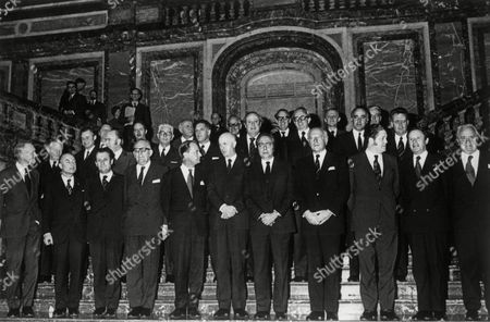 FILE - In this Jan. 15, 1973 file photo, family photo of the enlarged European Economic Community foreign ministers and members at the opening meeting at the Palais D'Egmont in Brussels, Belgium on Jan. 15, 1973. Front row L-R: British Foreign Minister Sir Alec Douglas-Home; Dutch Foreign Minister Wilhelm Klaus Norbert Schmelzer; Mario Pedini of Italy; French Foreign Minister Maurice Schumann; Ivar Noergaard Foreign Minister for Denmark; Belgium's Pierre Harmel; Common Market President Francois-Xavier Ortoli; West German Foreign Minister Walter Scheel; Irish Foreign Minister Brian Lenihan; Gaston Thorn Foreign Minister of Luxembourg; and Secretary General of the Council Mr. Calmas. Britain voted in a referendum Thursday, June 23, 2016 to leave the European Union. Britain was not included when the precursor to the EU was formed following World War II, but finally joined the group, known at the time as the European Economic Community, or the Common Market, on Jan. 1, 1973. The Associated Press is making its original coverage from that day available with photos.
