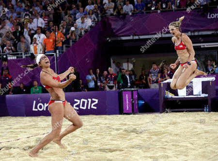 Stock Image of FILE - In this Aug. 8, 2012, file photo, Miss May Treanor, left, and Kerri Walsh Jennings celebrate a win over April Ross and Jennifer Kessy during the women's Gold Medal beach volleyball match at the 2012 Summer Olympics in London.  When longtime partner Misty May-Treanor retired after the London Games, Walsh Jennings looked across the net to grab April Ross off the team they beat in the gold medal match.