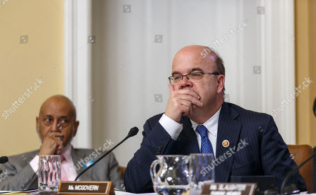 """James P. McGovern, Alcee Hastings Rep. James P. McGovern, D-Mass., center, joined by Rep. Alcee Hastings, D-Fla., left, questions the motivations of the Republican majority as the House Rules Committee meets to work on the creation of a special select committee to investigate the attack on the U.S. diplomatic outpost in Benghazi, Libya, that killed the ambassador and three other Americans, at the Capitol in Washington, . House Republicans on Wednesday moved toward an election-year special investigation of the deadly attack, brushing aside Democratic concerns over the panel's scope and composition. The Obama administration, meanwhile, accused Republicans of """"political motivation"""" after they issued a fundraising email linked to the Benghazi probe"""