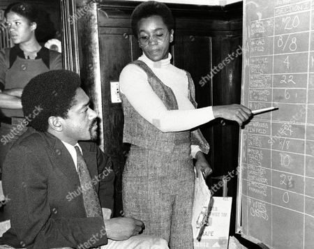 Bobby Seale checks with campaign worker Audrea Jones as he keeps tab on the voting in municipal election on in Oakland, Calif. Seale, Black Panther Chairman, is one of the candidates running for mayor of Oakland