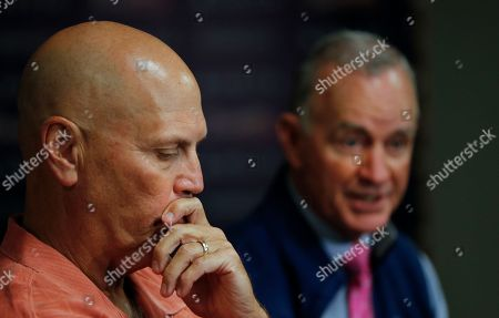 John Hart, Brian Snitker Atlanta Braves interim manager Brian Snitker, left, listens as the team's president of baseball operations John Hart speaks during a news conference, in Atlanta. Hart and general manager John Coppolella both said that Snitker is in the running to keep his job based on the way the team responded to his leadership