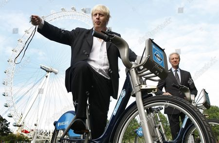 Stock Picture of FILE - In this Friday, July 30, 2010 file photo, Boris Johnson Mayor of London, left, with the Chairman of Britain's Barclays Bank Marcus Agius as they poses for the media as a new cycle hire scheme starts in London. Britain's new top diplomat is shaggy-haired, Latin-spouting Boris Johnson, who in recent months has made insulting and vulgar comments about the presidents of the United States and Turkey.