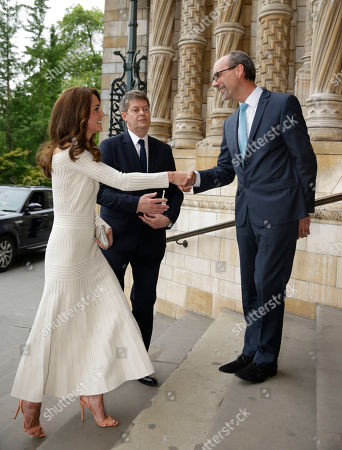 Britain's Kate the Duchess of Cambridge is greeted by Sir Michael Dixon, left, the Director of the Natural History Museum and Stephen Deuchar, right, the director of the Art Fund as she arrives to present the Art Fund Museum of the Year 2016 prize at a dinner hosted at the Natural History Museum in London, Wednesday, July 6, 2016. The Art Fund Museum of the Year prize is awarded annually to one outstanding museum which has shown exceptional imagination, innovation and achievement in the preceding year.