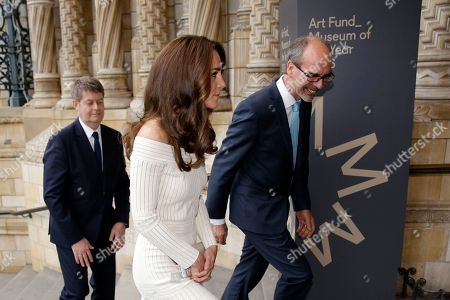 Britain's Kate the Duchess of Cambridge walks with Stephen Deuchar, right, the director of the Art Fund and Michael Dixon the Director of the Natural History Museum as she arrives ahead of presenting the Art Fund Museum of the Year 2016 prize at a dinner hosted at the Natural History Museum in London, Wednesday, July 6, 2016. The Art Fund Museum of the Year prize is awarded annually to one outstanding museum which has shown exceptional imagination, innovation and achievement in the preceding year.