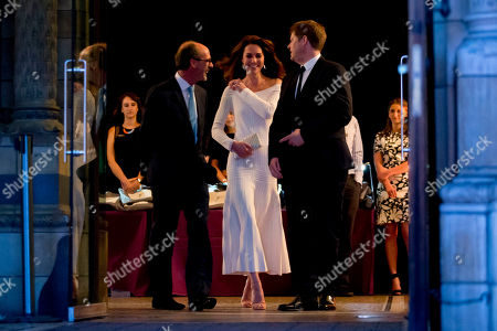 Britain's Kate the Duchess of Cambridge talks to Michael Dixon, right, the Director of the Natural History Museum and Stephen Deuchar, left, the director of the Art Fund as she leaves after announcing the Victoria and Albert Museum as the winner of the Art Fund Museum of the Year 2016 prize, at the Natural History Museum in London, Wednesday, July 6, 2016. The Art Fund Museum of the Year prize is awarded annually to one outstanding museum which has shown exceptional imagination, innovation and achievement in the preceding year.
