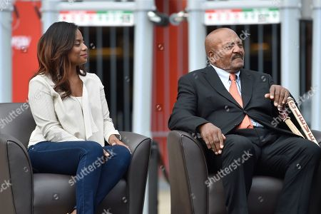 Jim Brown, Monique Brown Cleveland Browns Pro Football Hall of Famer Jim Brown, right, sits with his wife Monique, left, as he is honored with a statue outside FirstEnergy Stadium before an NFL football game against the Baltimore Ravens, in Cleveland