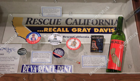 This, photo shows a display of campaign paraphernalia from the 2003 recall election of Gov. Gray Davis at the State Archives in Sacramento, Calif. The California initiative process will celebrate it's 100 anniversary on Oct. 10, with mixed reviews. Past by the voters in 1911, it was meant to wrestle power from lawmakers who failed to act to the needs of the public. A century later, the initiative process has become as quintessentially California as sunshine and opportunity, even if it has left a legacy of unintended consequences