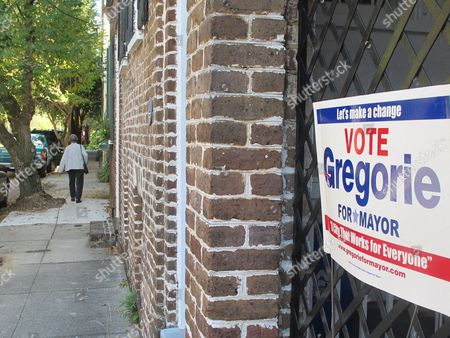 A campaign sign for Charleston Councilman William Dudley Gregorie hangs from a gate on a quiet side street in Charleston, S.C. Gregorie is one of four candidates opposing long time Charleston Mayor Joseph P. Riley Jr., who is seeking a 10th term in the city's municipal election on Nov. 8