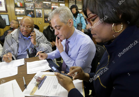 Rahm Emanuel, Michelle Harris Chicago Mayor Rahm Emanuel, center, and 8th ward Alderman Michelle Harris, right, join phone bank workers on election day, in Chicago. Emanuel hopes to avoid a runoff election, as voters head to the polls and decide whether to give the former White House chief of staff a second term in office