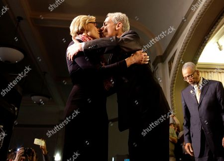 Stock Image of Rahm Emanuel, Amy Rule Chicago Mayor Rahm Emanuel, right, kisses his wife, Amy Rule, as they celebrate a victorious election night at Plumbers Local 130 Union Hall, in Chicago. Emanuel won a second term Tuesday