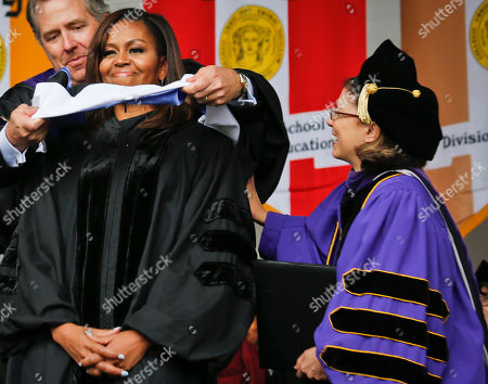 Stock Picture of Michelle Obama, James Milliken, Lisa Coico FILE--In this photo from, City University of New York Chancellor James Milliken, left, and City College of New York (CCNY) President Lisa Coico, right, confers First Lady Michelle Obama with a honorary degree, during commencement at CCNY in New York. Coico resigned Friday, Oct. 10, 2016, amid questions over the handling of personal expenses and a call for a state investigation