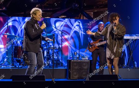 Stock Picture of Michael Bolton, Jena Irene Asciutto Michael Bolton sings with Jena Irene Asciutto at the Connected by HARMAN Gala at the Henry Ford Museum, in Dearborn, Michigan