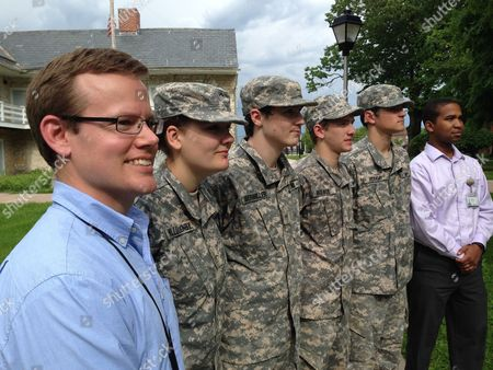 In this May 23, 2016 photo, Maryland School for the Deaf government and history teacher Keith Nolan, left, stands at attention with school Cadet Corps members, left to right, Jennida Willoughby, Maverick Obermiller, Blake Brewer and Kiser Holliday, and school audiologist David Alexander in Frederick, Maryland. Nolan wants the Defense Department to allow deaf people to enter the armed services.