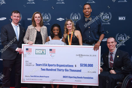 Ryan Eckel, Lauren Hobart, Simone Biles, Allysa Seely, Jeremy Taiwo, Dan McCoy From left, DICK'S Sporting Goods Vice President of Brand Marketing Ryan Eckel; and EVP and Chief Marketing Officer Lauren Hobart are joined by Olympians and Paralympians Simone Biles, Allysa Seely, Jeremy Taiwo, and Dan McCoy to present a $236,000 donation from The DICK'S Sporting Goods Foundation to USOC youth sports organizations at the Team USA Awards, in Washington. DICK'S Sporting Goods Every Medal Program pledged $1,000 for every medal won by Team USA at the Olympic and Paralympic Games in Rio
