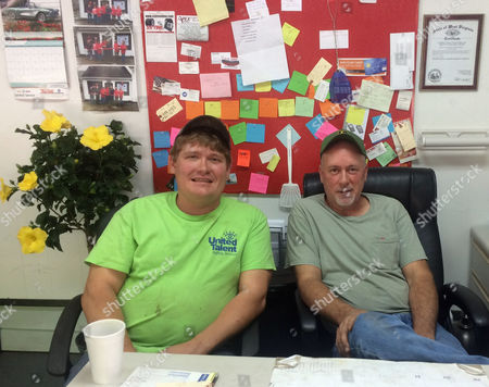 Stock Image of ADVANCE FOR USE MONDAY, JULY 18, 2016 AND THEREAFTER-Albert Adams and Leslie Arthur, who own Big Al's Auto and Small Engine Repair, sit in their offices in Logan, W.Va,. on May 11, 2016. They quit their jobs in the mines when they figured the industry wouldn't bounce back and started this shop to try to build a life after coal. They said they are working on a disabled miner's car on credit because jobs are scarce and families are hurting to make ends meet.