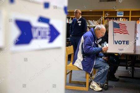 Stock Photo of Steve Maskell Steve Maskell, of McLean, Va., right, votes in an election that includes the Virginia gubernatorial race between Republican Ken Cuccinelli and Democrat Terry McAuliffe on election day in McLean, Va