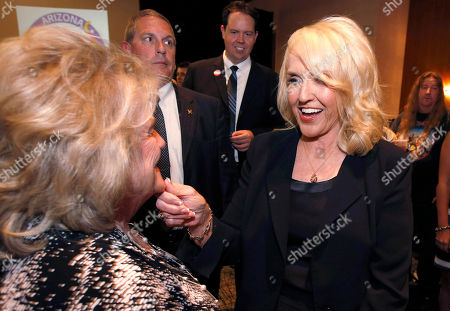 Jan Brewer, Wally Campbell Gov. Jan Brewer, right, squeezes the chin of Wally Campbell, a Goodyear, Ariz. city council member, during Republican party election night festivities in Phoenix on . Brewer will be succeeded by Republican gubernatorial candidate Doug Ducey or Democratic candidate Fred DuVal