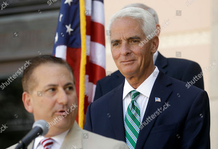 Charlie Crist, Rick Kriseman Former Florida Gov. Charlie Crist, right, listens to St. Petersburg Mayor Rick Kriseman during a news conference in St. Petersburg, Fla. Crist is running as a democrat for the U.S. House of Representatives for the 13th District in Florida